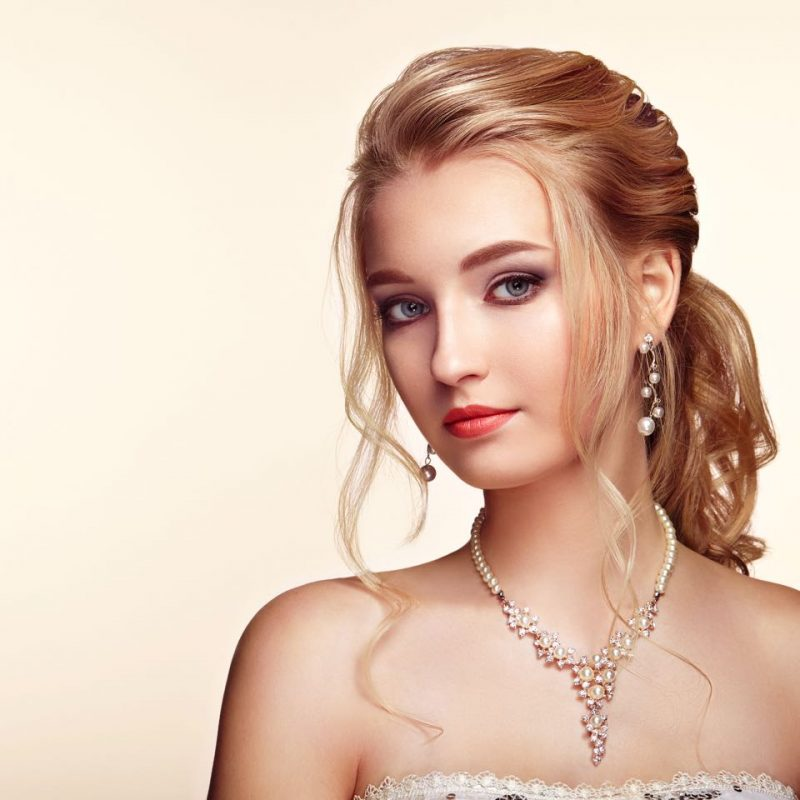 blonde-girl-with-long-and-shiny-curly-hair-PDZZ7YZ.jpg
